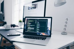 DaaS Desktop as a Service for small business, computer with code